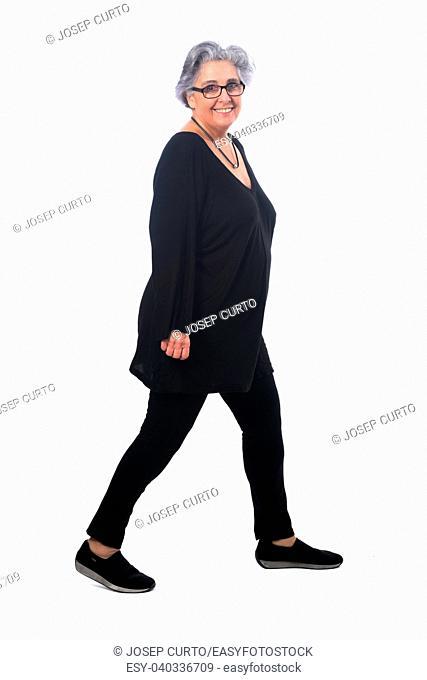 full portrait of a senir woman walking on white