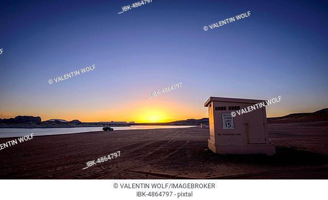 Beach cabin at sunrise, sandy beach of Lone Rock Beach at Lake Powell, Glen Canyon National Recreation Area, Page, Utah, USA