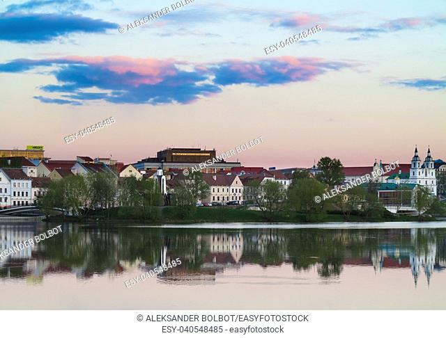 Minsk,BELARUS-11 MAY 2017:Old town of Minsk in sunset soft light with Niemen River in foreground, Belarus, Europe