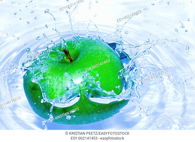 Green apple splashing in water, lovely colour and great reflections on every single drop  Very sharp, you can see the texture of the fruit taken with F9