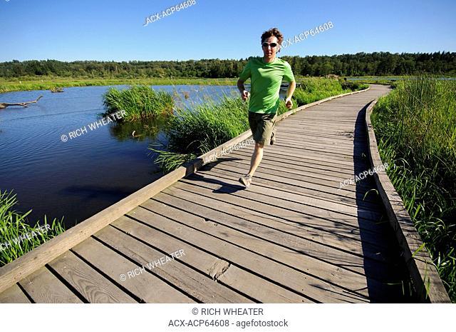 Trail running at Burnaby Lake Regional Park, Burnaby, British Columbia, Canada