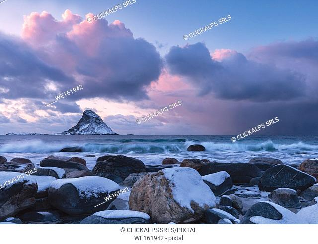 Storm at sunset from the white beach of Bleiksstranda with the Bleiksoya island in the background Bleik Andøya Vesteralen district of Nordland county Norway...