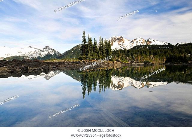 Mount Price and Clinker Peak right and the Sphinx Glacier left provide a beautiful backdrop to Garibaldi Lake and the Battleship Islands in Garibaldi Provincial...
