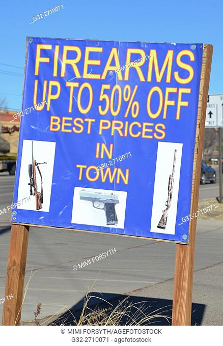 Sign advertising firearms at discount, New Mexico, USA