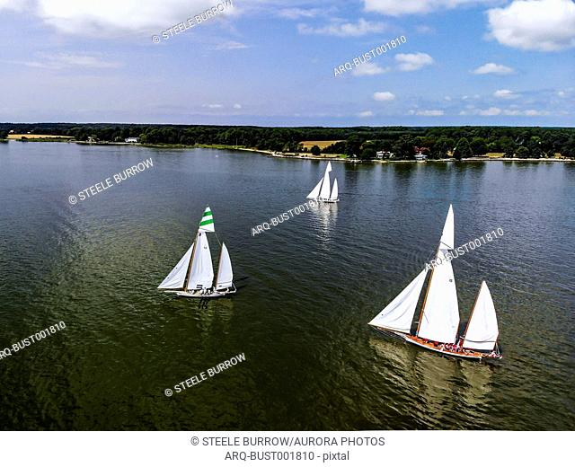 Sailboats participate in a sailing regatta on the Eastern Shore of Maryland during a warm summer day. Located several hours from Washington, DC