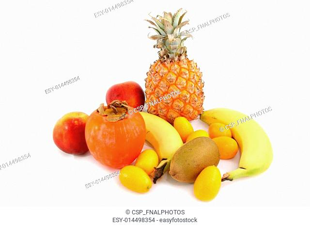 several tropical fruits arranged over a white beackground