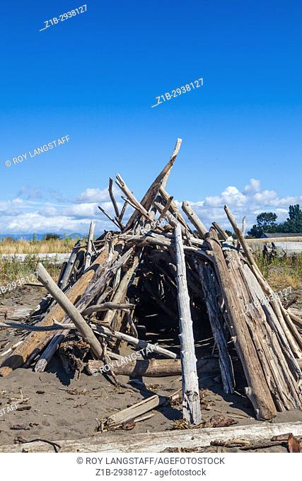 Childrens fort constructed from driftwood on the beach at Steveston near Vancouver, Canada
