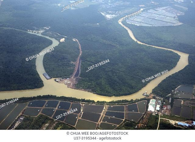 Aerial view of rivers and fish ponds around Sepang area from plane, Selangor state, Malaysia