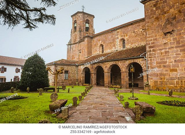 Church of the Assumption on a foggy morning. Around the church you can see the remains of an ancient cemetery with discoid steles cut from stone from the...