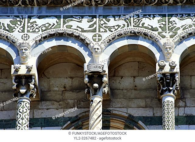 Close up of the Arcades columns & statues of St Michele of the 13th century Romanesque facade of the San Michele in Foro