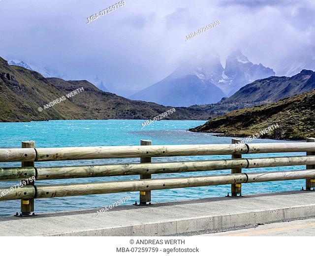 Bridge over lake Lago el Toro, Paine Horns in the background, Torres del Paine, Patagonia, Chile