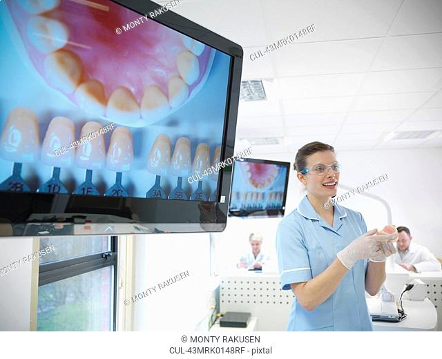 Dentist teaching students in lab