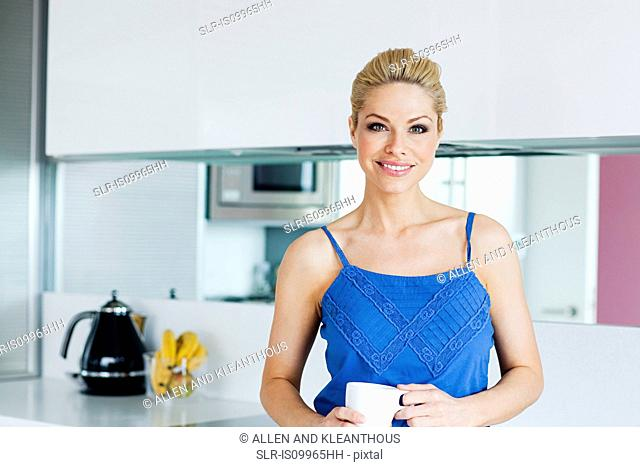 Woman in kitchen, portrait
