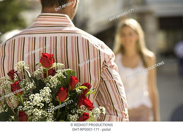 Couple, man with flowers