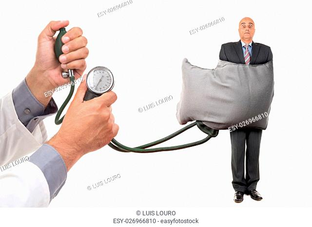 Businessman wrapped in a blood pressure measure device isolated in white