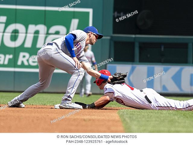Washington Nationals shortstop Trea Turner (7) steals second as New York Mets second baseman Joe Panik (2) attempt to tag him out in the first inning of the...