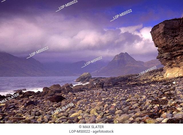 Scotland, Isle of Skye, Strathaird, View of beach with eroded cliff face