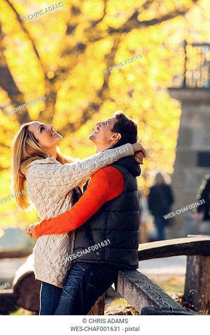 Happy couple enjoying autumn in a park