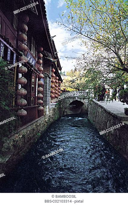 Stream by houses, Historic building of old Lijiang city, Lijiang City, Yunnan Province of People's Republic of China