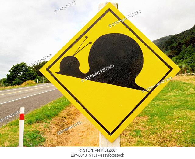 Fake attention Kauri Snail Crossing Road Sign