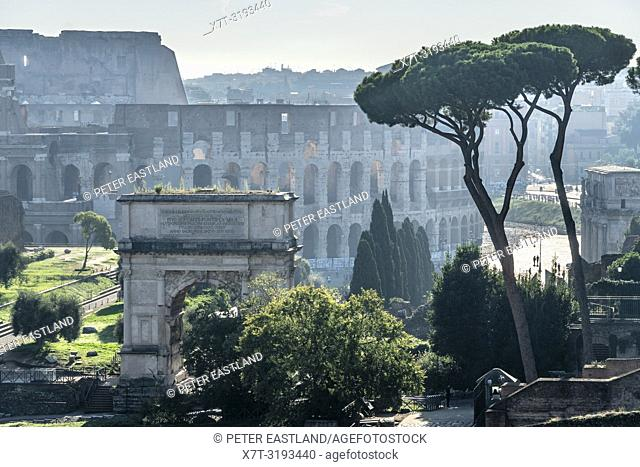 Early morning view across The Roman Forum towards the Arch of Titus , with the Colosseum in the background, Rome, Italy