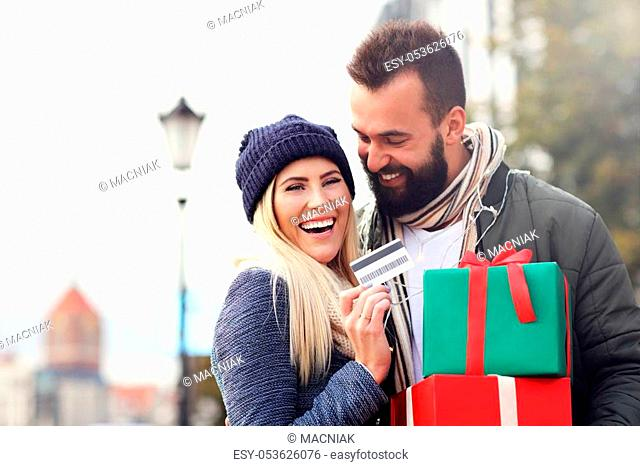 Picture showing a couple shopping for Christmas in the city