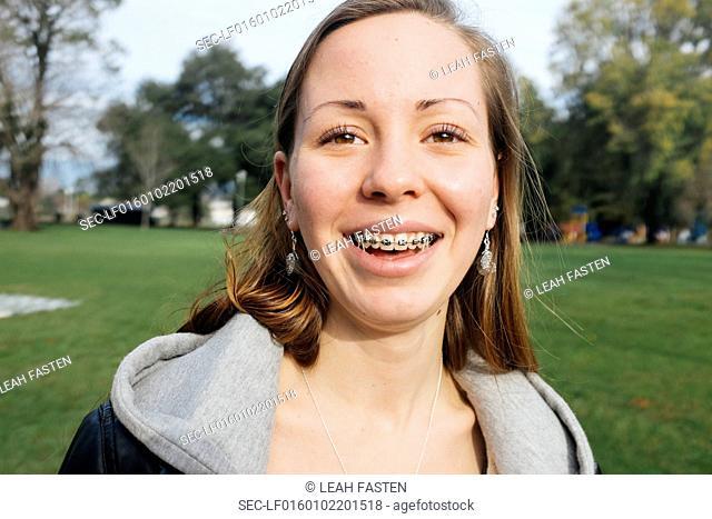 Portrait of smiling girl (16-17) in park