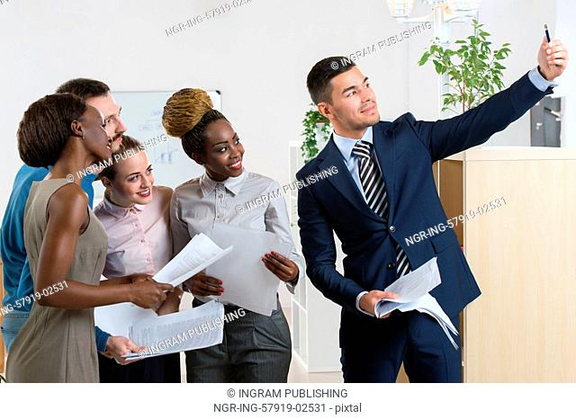 Portrait Of Business Team Capturing Selfie Together at Office