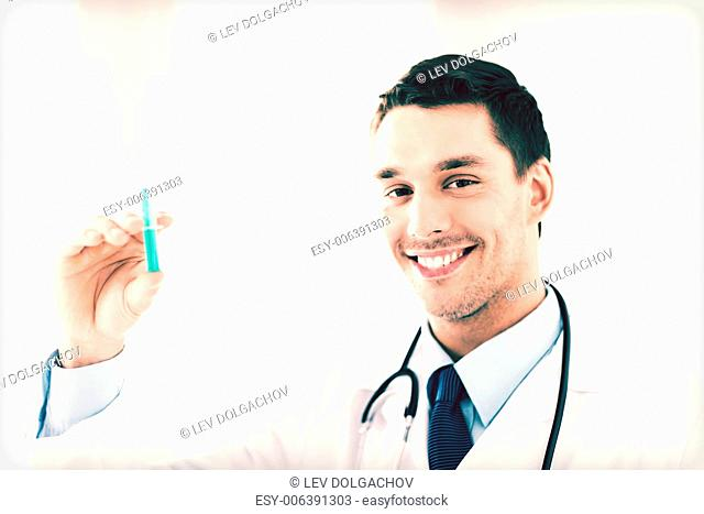 close up of male doctor holding syringe with injection