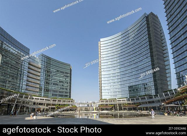 MILAN, ITALY - August 20 2020: cityscape with almost no people around main pond at business hub urban renewal development, shot on august 20 2020 at Milan