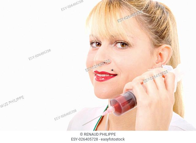 an happy smiling young female doctor with syringe , on white