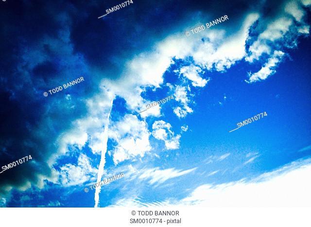 Altocumulus clouds and contrail