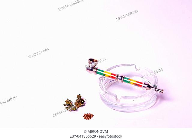 kidneys and cones with leaves medical marijuana with a tube for smoking treatment hemp sedative