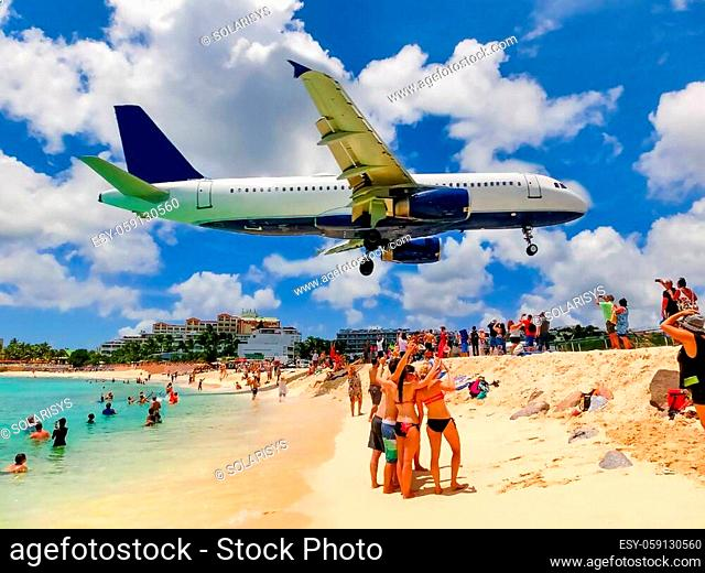 The people making photos at Maho Bay beach. It is one of the world's premier planespotting destinations