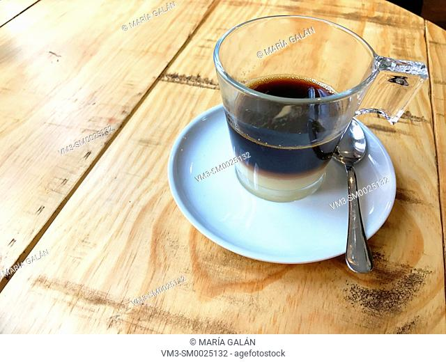 Cup of Bombon coffee on wooden table