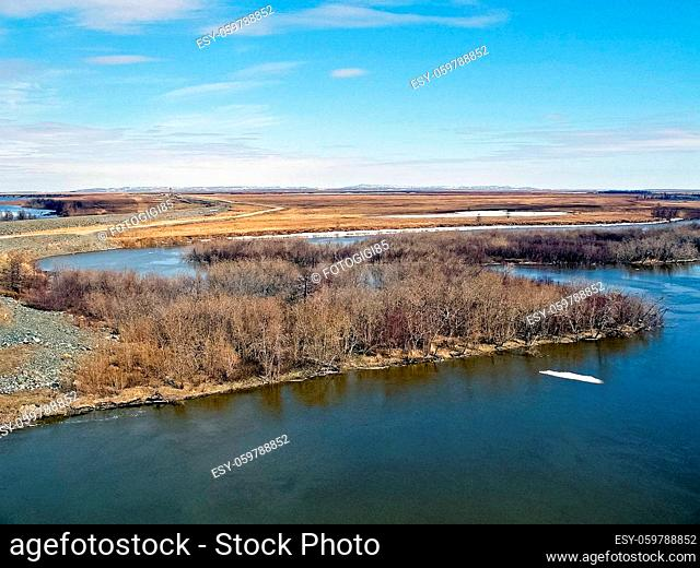 River landscape Early spring. bare trees, melting snow