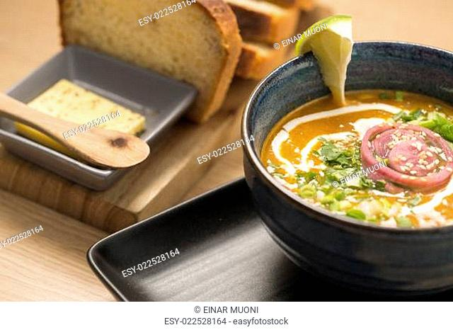 Zoomed bowl with delicious soup