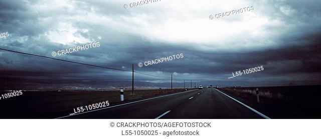 Road landscape with storm clouds
