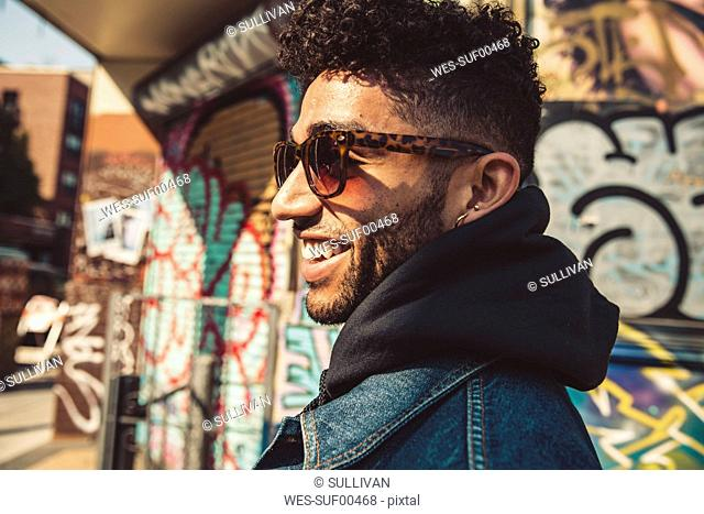Portrait of smiling stylish young man outdoors