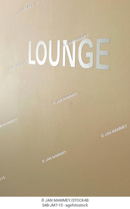 Single word lounge at wall