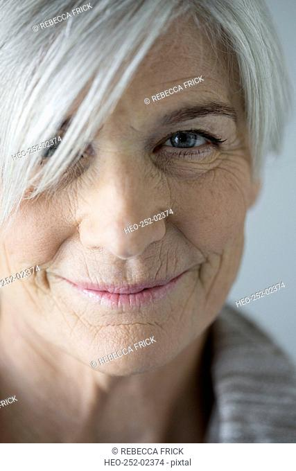 Close up portrait smiling senior woman