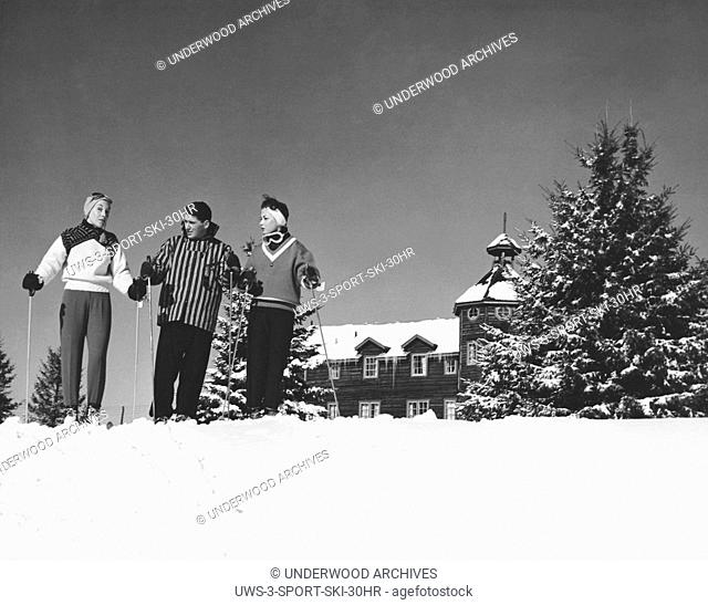 Saint-Sauveur, Quebec, Canada: c. 1955. Three skiers in front of Nymark's Lodge in the Laurentian Mountain resort town of Saint-Sauveur in Quebec
