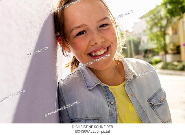 Teenage girl smiling, portrait