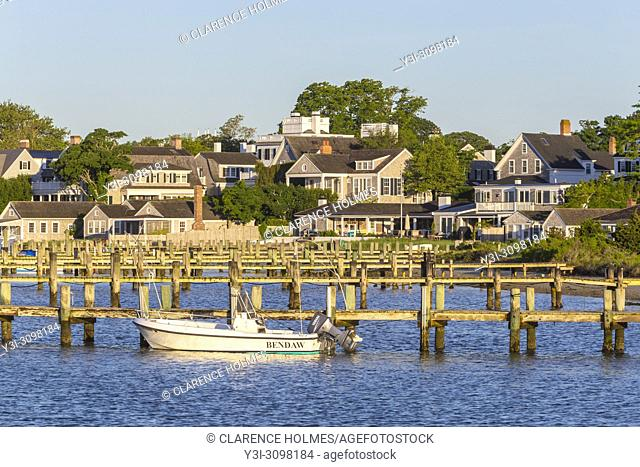 Boats moored and docked in the harbor, overlooked by stately captain's homes in Edgartown, Massachusetts on Martha's Vineyard