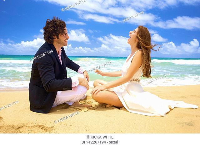 Couple on a beach; Kealia, Kauai, Hawaii, United States of America