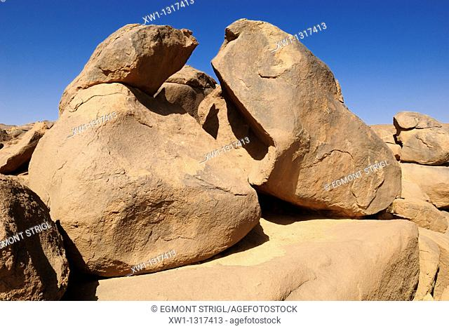 cracked granite boulders in the Hoggar, Ahaggar Mountains, Wilaya Tamanrasset, Algeria, Sahara, North Africa