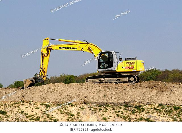 Yellow excavator on a slope
