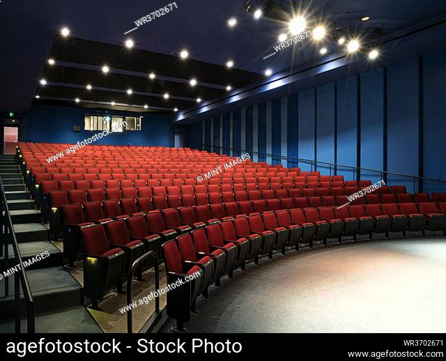 Empty auditorium, rows of raked seats