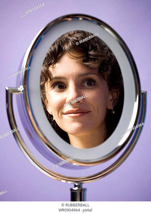 Close-up of a young womans reflection in a mirror