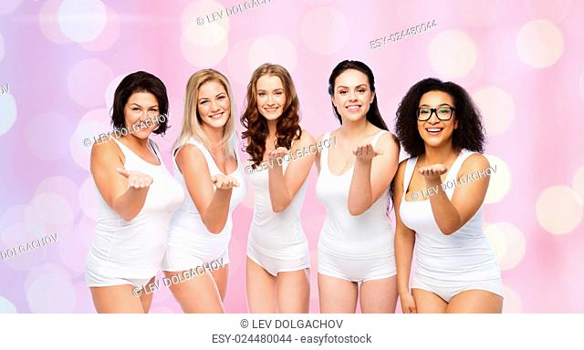 love, friendship, beauty, body positive and people concept - group of happy plus size women in white underwear sending blow kiss over rose quartz and serenity...